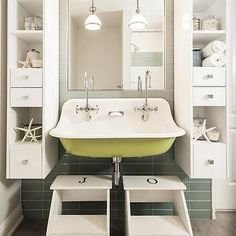 Kids Bathroom Features Tall And Slim Floating Display Cabinets Mounted On Gray Gl Tiles In Grid Formation Flanking Mirror Over Yellow Trough Sink