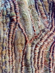 Julia Wright fabric manipulation and vouching with hand stitch and rust dying
