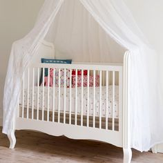 white cot with canopy