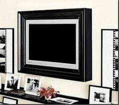diy framed tv.. this one is from pottery barn.. her version looks much better but the photo is too small to upload.