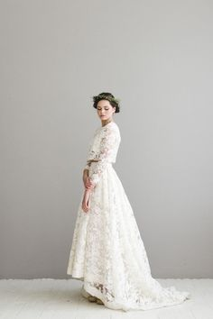This sweet lacy thing from Houghton NYC. | 21 Completely Stunning Crop Top Wedding Gowns