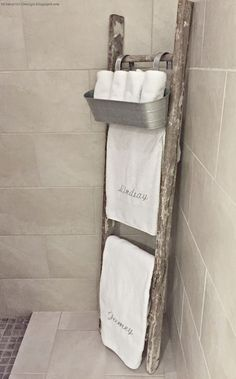 Whimsy Girl Design: Master Bathroom.  Old rustic ladder used as towel rack with galvanized hanging bucket for wash cloths.