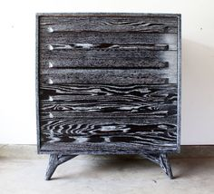 Love the striking finish on this vintage chest of drawers.