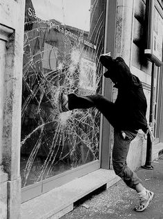 """LET HER GO!"" Blaise yells as he kicks through the glass of the small town shop. The glass shatters around him and he looks straight at te camera. ""Do I have to come in, or will you let her out?"" He angrily asks."