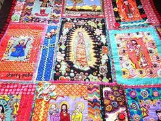 Kitschy Mexican Saints Quilt by humboldtcherry on Craftster.  Teesha Moore style quilting with Alexander Henry fabrics.