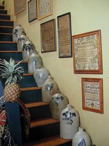 Collection of old...crocks that line the stairs. I love this, but it is definitely for a kid-free and pet free home! I visualize the domino effect. Antique Crocks, Old Crocks, Stoneware Crocks, Antique Stoneware, Primitive Crafts, Primitive Country, Primitive Antiques, Primitive Homes, Prim Decor