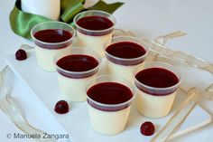 White Chocolate Panna Cotta with Raspberry Coulis. Cool as shooters, but by all means I would unmold these on a plate and pour the coulis on top. The contrast of colors is startling. Fabulous for Halloween desert--like blood on snow...