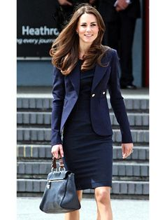 June 30: En Route to North America  Kate went for a professional look as she and Prince William set off on their 11 day tour of North America. Her all-navy outfit included a Rouland Mouret silk dress with a Smythe one button blazer. She finished off the look with a Mulberry bag and navy Manolo Blahniks.    Read more: Kate Middleton Leaving on North America Tour - Kate Middleton Navy Outfit Royal Tour - Harper's BAZAAR