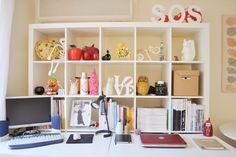 microscope, mini love sculpture, rubik cube, stake of magazines