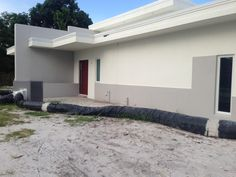 Stucco and paint complete. Temp AC unit to keep the crews comfy and productive in the heat.