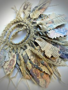 manuscripts...  I could get lost in this woman's work.  It's so varied and creative.  Amazing, makes me want to get back to polymer clay again.