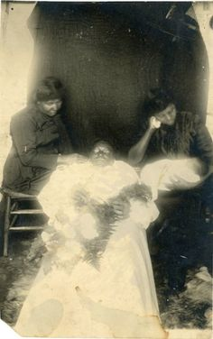 Beautiful photo of a young woman who apparently died in childbirth or shortly afterwards. The baby may also be deceased. A rare example of African American mourning photography.