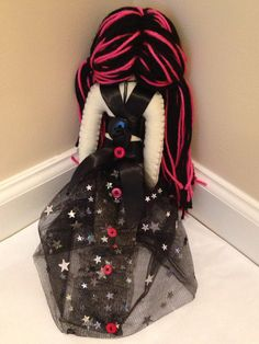 Lux is a riot grrrl, punk rock princess decked out in pink and black. She is approximately 12 inches tall (the dress makes her look taller, but when she is leaning against something with the dress gathering around her, she is approximately 12 inches tall). Her body is made from a
