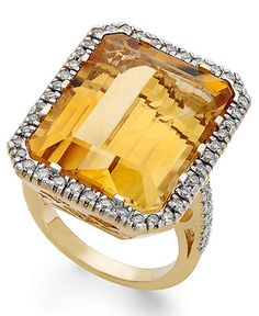 With its bold burst of color, this sophisticated cocktail ring makes a decidedly brilliant statement. The elegant 14k gold design showcases an emerald-cut citrine (22 ct. t.w.), beautifully highlighte