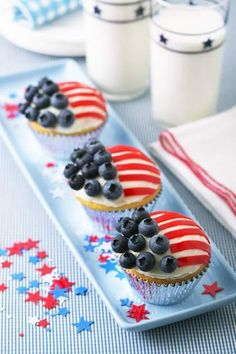 Wave the Flag Cupcakes...thinking of individual angel food or pound cakes with fresh whipped topping, strawberries instead of fruit roll up and blueberries.