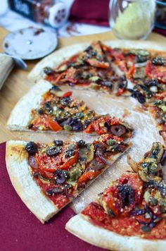 You won't miss the dairy on this one. Salty olives, capers and fresh tomato slices with carmalized onions and mushrooms. Topped with homemade vegan parmasan cheese. Vegan Pesto, Vegetarian Recipes, Vegetarian Pizza, Vegan Pizza Recipe, Vegan Food, Caramelized Onions And Mushrooms, Dairy Free Pesto, Gluten Free, Recipes