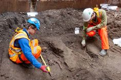 The remains were found in an 18-foot-diameter (5.5 meters) shaft about 8 feet (2.5 m) below the road around Charterhouse Square gardens, near to the former Carthusian Monastery.