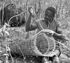 Angolan fisherman making fishing tackle. 1970
