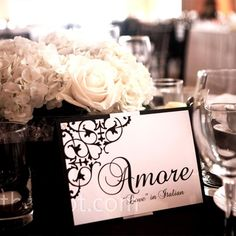 Each table named after the word love in a different language and marked with black and white table cards that matched the other wedding stationery.