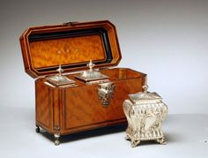 Satinwood tea caddy // A fine satinwood tea caddy with silver filigree top handle and escutcheon, also having silver ball and claw feet. The interior with three canister, hallmarked 1758. The box by William Grundy.  Height: 8 1/2 inches Width: 11 1/2 inches Depth: 5 inches  // //  - Maria Elena Garcia -  ► www.pinterest.com/megardel/ ◀︎