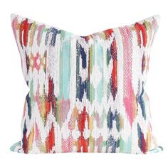 A multi-coloured boho inspired pillow in candy pink, turquoise, navy blue, grass green, saffron yellow and orange-red and cream. Made in Canada.