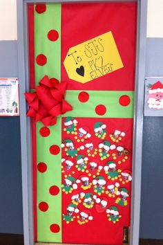 Classroom Door for December   cut out construction paper circles and put glitter on them for the dots and made the bow out of bulletin board paper.  print out the kids pictures and made elves.  take it down and put a hole at the top and tie string on so they can take it home and make it an ornament on their tree!