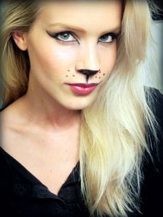 You can't go wrong with a cat costume, and we particularly love this one because of how trendy the cat eye has become this year. Simply line your eyes and black out the tip of your nose for a feline look.Image via Beauty Lovin