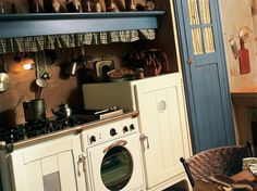 Marchi Group - Doria Rustic kitchen in country style brick - vintage stove and tables and chairs