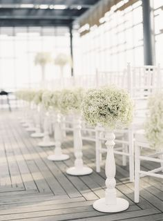 Modern florals: http://www.stylemepretty.com/2014/03/11/20-ways-to-style-your-aisle/