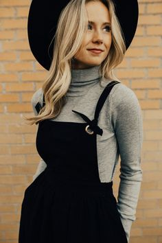 """Heather Grey Turtleneck Long Sleeved Ribbed Hem Detail Form Fitting Soft Stretch Material View Size Chart Model is 5'9"""" + Wearing a Small"""