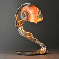 Like the idea of a shell light. Art Nouveau Figural Table Lamp with Shell Shade. Silvered-metal and shell. Antique Lamps, Vintage Lamps, Nautilus, Muebles Estilo Art Nouveau, Design Art Nouveau, Lampe Art Deco, Art Nouveau Furniture, Furniture Nyc, Office Furniture