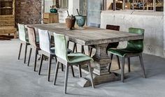 Beautiful reclaimed oak dining table with assorted vintage velvet chairs