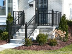 R1400 aluminum railing in black color.  Front porch and step railing.