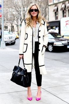 Sharp in a black and white coat (and bright pink pumps!)