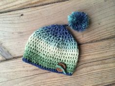 Crocheted beanie with pompom by creativehatsandmore on Etsy, $23.00