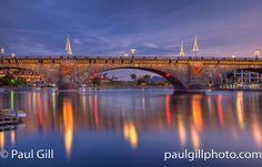 Christmas lights on the London Bridge at twilight. Lake Havasu City, Arizona...Colorado River.