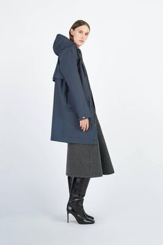 The Ekeby raincoat is a travel friendly, unisex style handmade in a light weight material. The coat is made with strong attention to detail like raglan sleeves, a front zipper, cotton strings on the hood and adjustable snap buttons at the sleeve ends. Navy Raincoat, Hooded Raincoat, Cotton String, Front Bottoms, Raincoats For Women, Rain Wear, Navy Women, Unisex Fashion