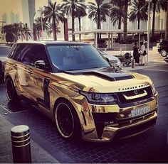 This is how Mario Balotelli rolls...all up in gold.