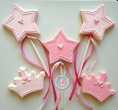 Princess cookies~                  By SugarySweetCookies. Perfect cookies for that little princess in your life.Cookies are made just for you and expertly decorated.Set comes with 12 cookies in each of the following designs:4. Light Pink Crowns (3inches)4. Medium Pink Crowns (3inches)4. Star Wands with matching ribbon (3inches)Each cookie comes individually sealed and wrapped for max protection and freshness.Fell free to message me for any customization and additional questions.