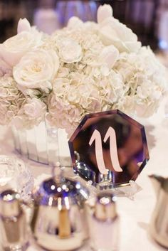 Wedding reception centerpiece idea; Featured Photographer: Bridgette Marie Photography, Featured Planner: BTS Event Management