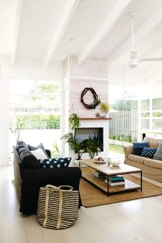 White living room with blue accents and fireplace