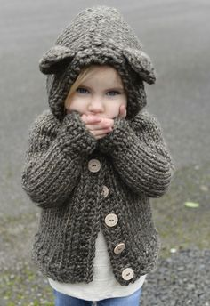 Knit this bear-y cute cardigan by The Velvet Acorn for your little one! Bladyn Bear Sweater pattern by Heidi May, made with Lion Brand Hometown USA and sizes 13 & 15 knitting needles. Find the pattern on Ravelry.