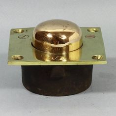 We are calling this antique because it looks antique. A very robustly constructed brass and bronze pop up doorstop with no rough or sharp edges and no sticky out bits. Projection from the floor pate when fully extended: 1.6 cm and when fully depressed: 1 cm. Of the very best quality with a good strong spring. Fit mounting plate flush with floor surface. Depress button with foot so that door passes over and the button will pop up, holding the door open. Depth of recess required 3.8 cm.