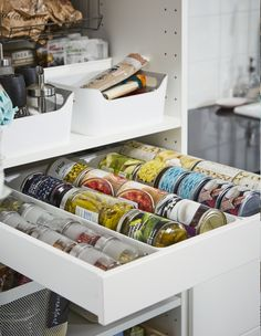 Say goodbye to stacking cans, and hello to an organised pantry drawer! You'll be able to see and reach the very back with ease. Find more pantry storage tips, right now at #IKEAIDEAS