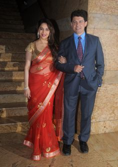 Madhuri Dixit Nene with husband Sriram Nene at the launch of Dilip Kumar's autobography. #Style #Bollywood #Fashion #Beauty