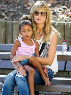 An aviator-wearin' Heidi Klum spent some mommy/daughter time with lil Lou during a soccer game! How adorable is this duo?!