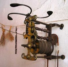 This 18th Century Clock Jack is still operational and can be found at the Webb Deane Stevens museum in Connecticut, USA. It is in the original home of Silas Deane, a contemporary of George Washington. The rope to the left connects to a stone outside which, once wound up, stores enough energy to rotate the spit for about 20 minutes. It would have been an expensive piece of equipment in those days, but families who could not afford one would have had to turn the spit by hand, close to the…
