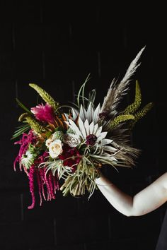 Contemporary large tropical bouquet for a north texas bride Designed by The Greenhouse 817 Photographed bt Kylie Hull #thegreenhouse817 #fortworthbride #dfwbride #wedding #bouquet #floraldesign