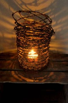 create a rustic atmosphere barbed wire and candle, crafts, repurposing upcycling, Rusty Barbed Wire Candle Holder