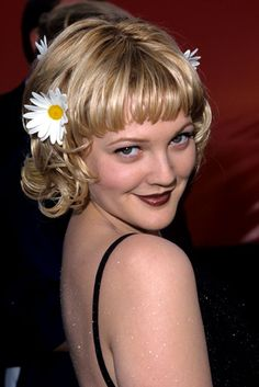 """Drew Barrymore poses at the Academy Awards So what if her look was more """"rave"""" than """"red carpet."""" Drew was 23, had her own production company, and she hadn't gotten together with Tom Green yet. Photo: WireImage"""